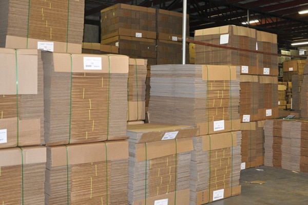 Corrugated Boxes Stacked in Warehouse - Ready to Ship - Leaman Container