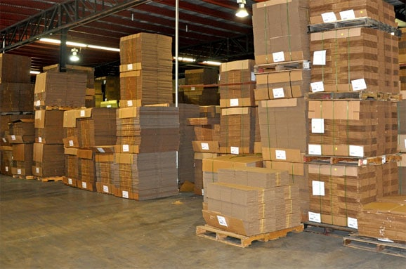Corrugated Cardboard Box Products Stacked in Warehouse - Leaman Container