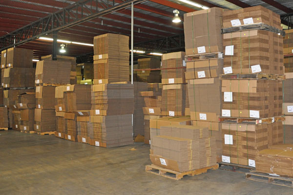 Boxes stacked for storage in warehouse - Leaman Container