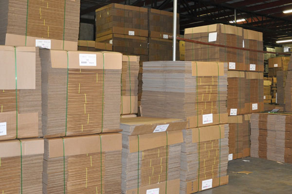 Stacked Corrugated Boxes in Warehouse - Leaman Container